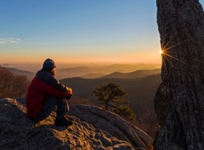 A hiker at sunset in Shenandoah National Park