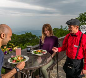 Couple with Server Dining at Terrace Seating at Big Meadows Lodge in Shenandoah National Park